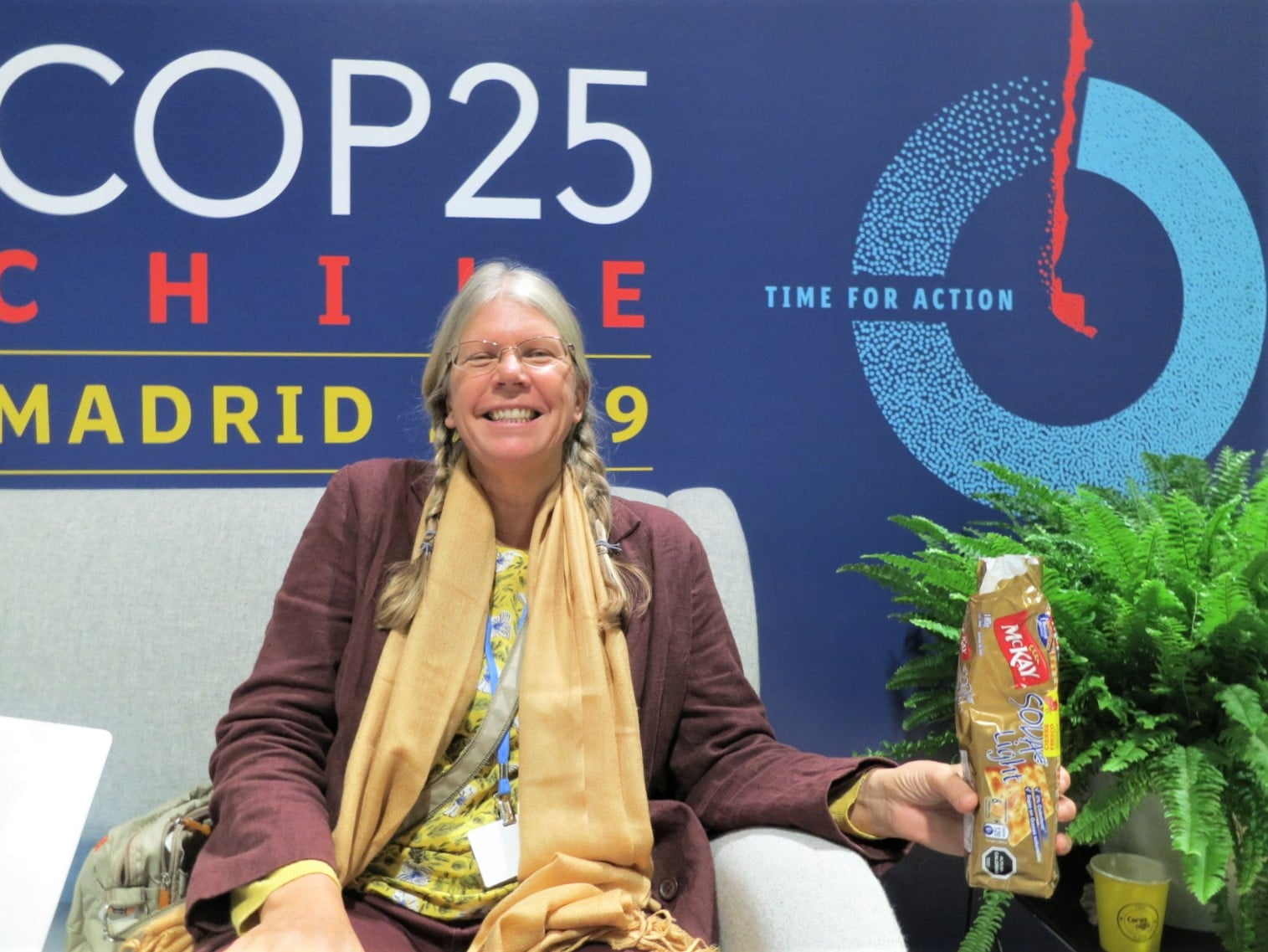 """Sonja Thunberg"" relaxing with crackers in front of the COP25 Logo.  It says, ""Time for Action"" and reminds us all of the cycle of time."