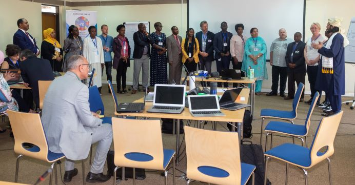 Group presentation on final day, Dr. Iyad  (in grey suit) listening