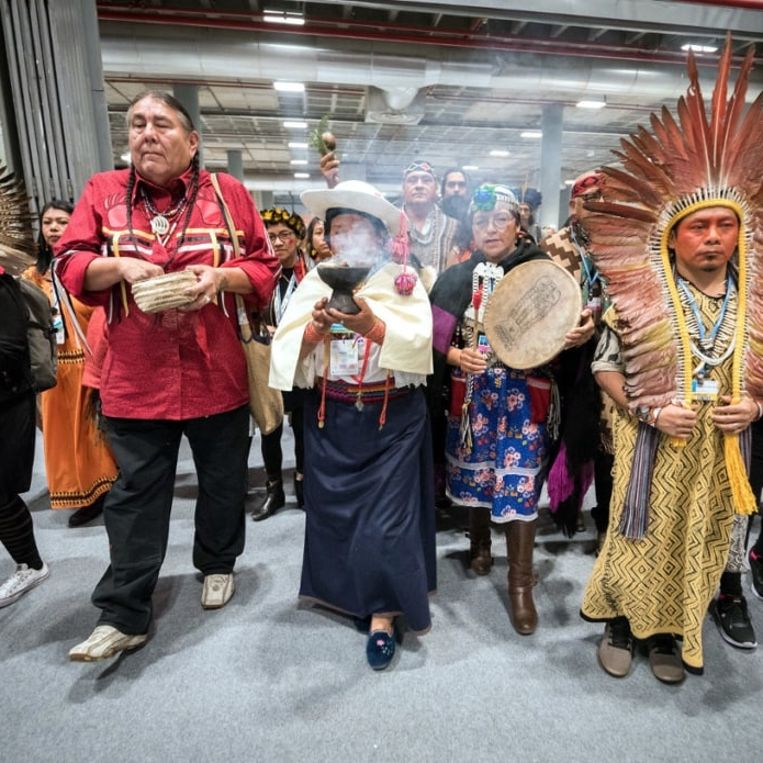 10 December 2019, Madrid, Spain: A group of indigenous people demonstrate at COP25 in Madrid.
